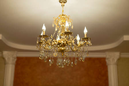 chandelier: gilded chandelier on the ceiling Stock Photo