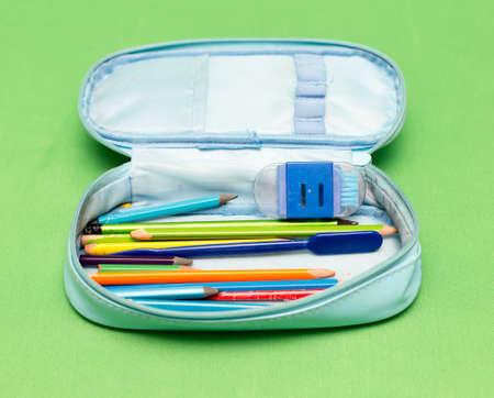 children's school pencil case on a green background