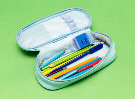children's school pencil case on a green background