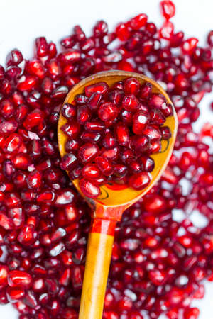 delicious berry pomegranate on a wooden spoon