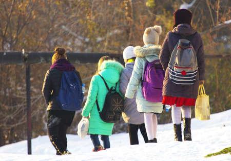 Winter, schoolgirls returning from school Stock Photo