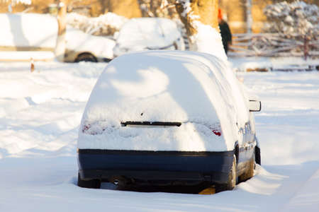 Car under the snow in the city Stock Photo