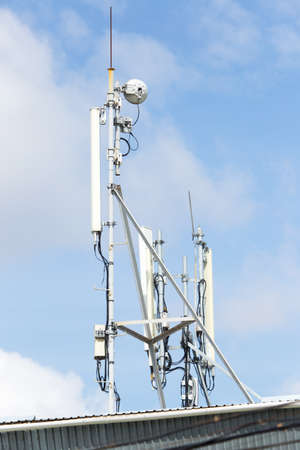 mobile antenna on a blue sky background