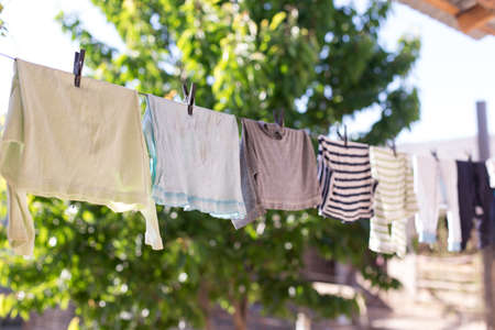 clean clothes, after washing on a rope 版權商用圖片