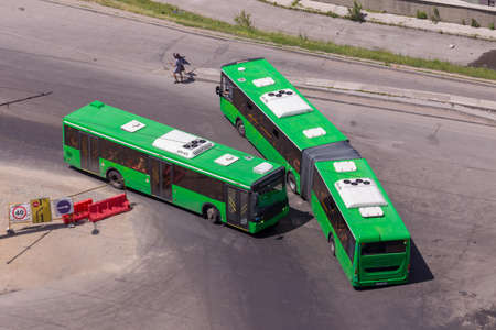 Vehicles designed to carry a large number of passengers on a city street. View from above
