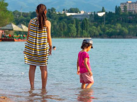 beach, mum watches the children when they swim Stok Fotoğraf