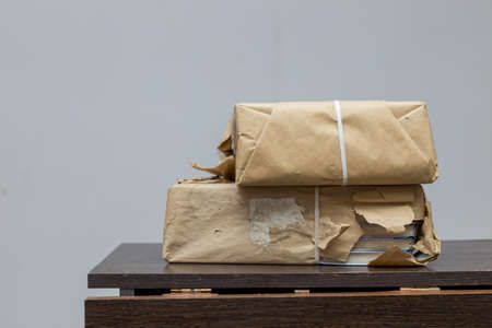 new books wrapped in brown paper on the table Stock Photo