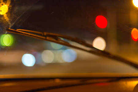 Artistic style - Defocused urban abstract texture ,blurred background with bokeh of city lights from car on street at night, vintage or retro color tone