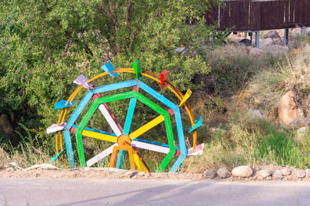 wooden turbine wheel pumping Stock Photo