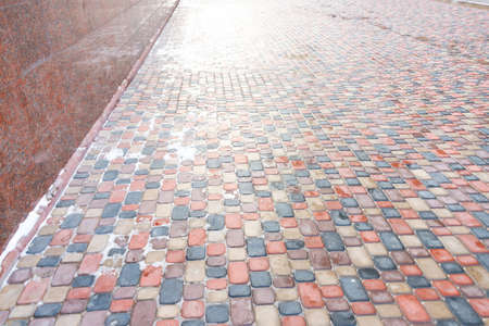 Abstract colorful background of sidewalk tiles - Sidewalk tile as a background for advertising Imagens - 115521916