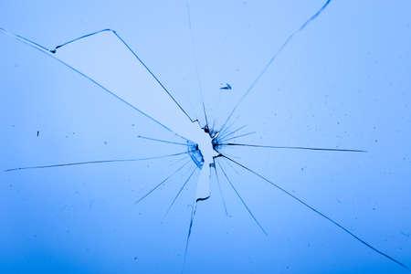 Broken glass on blue background, object background design texture
