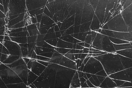 Broken glass on a black background, object background design texture