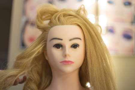 Training hairstyles on a mannequin Stok Fotoğraf