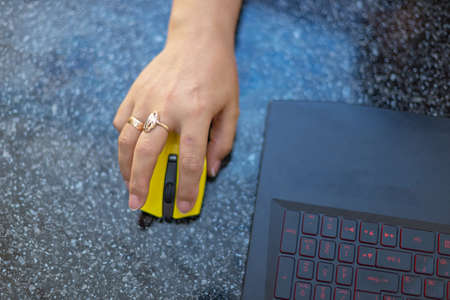 Close up of female hands use computer mounts