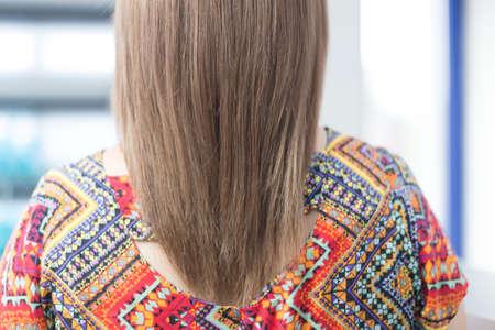 female head after lightening hair in a beauty salon