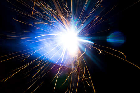 Welding sparks and smoke worker robot