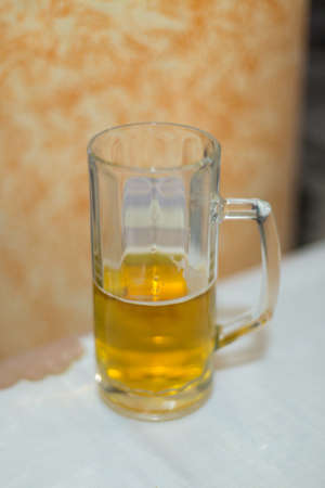 Glass of beer on the table