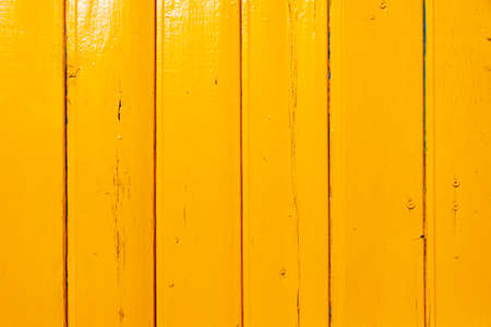 wood texture painted yellow with paints Фото со стока