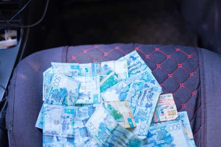 Kazakh money in a car seat