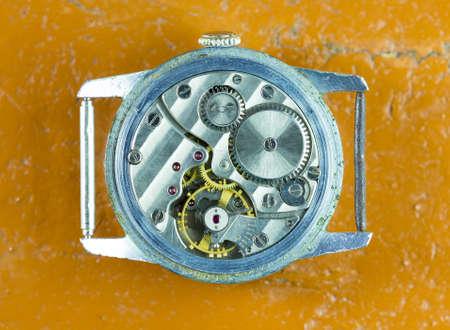 inside a mechanical clock on a table, yellow background 版權商用圖片