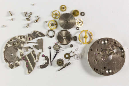 Spare parts from mechanical watches on a white background