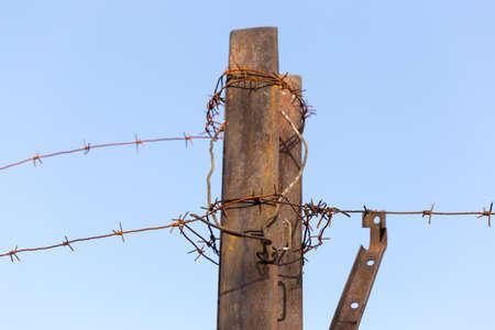 Barbed wire fence. Let. Prison. Spikes. Block. Prisoner.