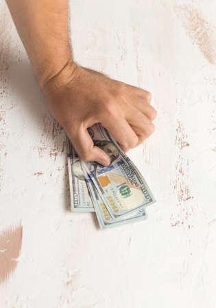 Mans hands holding hundred dollar bills. Business concept