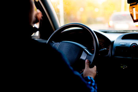 Close Up Man Hands Holding Steering Wheel While Driving A Car.