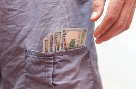 one hundred dollars banknote in your pocket. 版權商用圖片