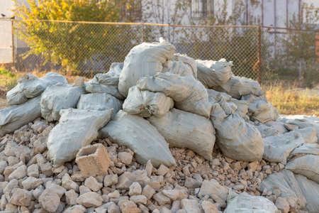 Broken concrete block, building debris in a pouch. Reklamní fotografie
