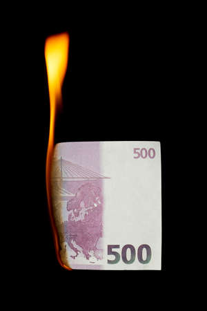 500 euro burns on a black background Stock Photo