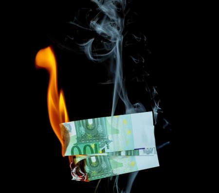 100 euro burns on a black background