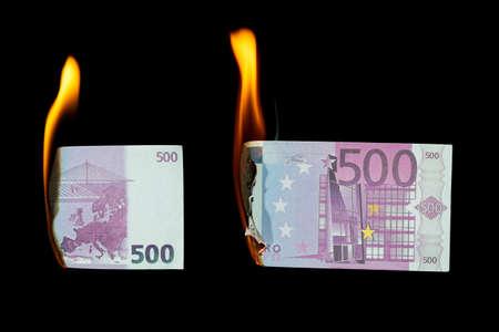 500 euro burns on a black background, both sides