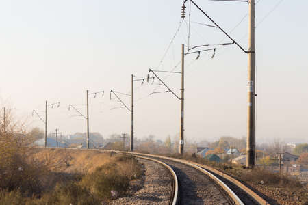 railway rails pillars wire horizon