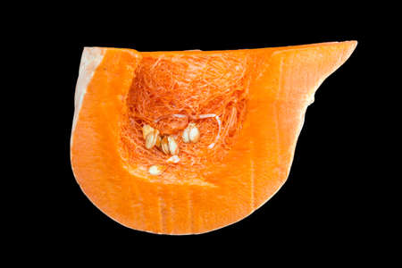 Sliced orange pumpkin, pulp close-up. Isolated on a black background. 스톡 콘텐츠