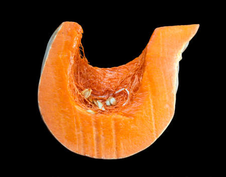 Sliced orange pumpkin, pulp close-up. Isolated on a black background. 스톡 콘텐츠 - 136251847