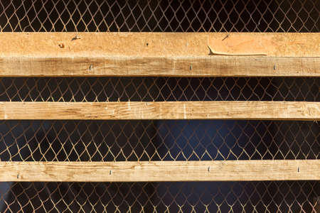 wooden grate and steel mesh on a black background 스톡 콘텐츠 - 136251924