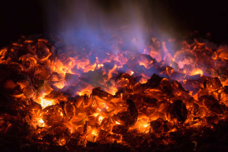 Texture embers closeup. Embers after a fire. 스톡 콘텐츠 - 136251925
