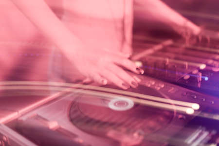 DJ mixing in a karaoke bar. Soft focus on hand - a concept of entertainment, youth, entertainment and relaxation Reklamní fotografie