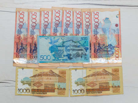 Kazakhstani currency 42500 tenge on the table. Living wage, state assistance to every citizen who lost income during a survival pandemic