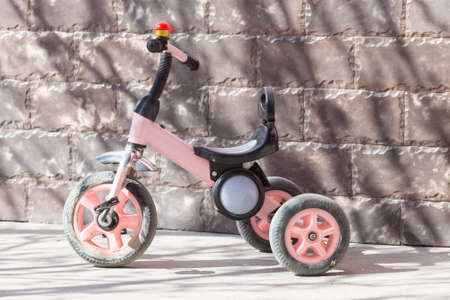 children's tricycle in the yard