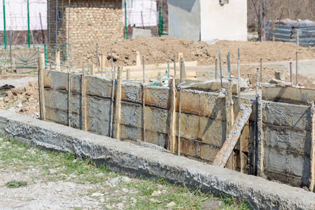 Formwork for the foundation of the house. Close-up of the foundation of a house made of concrete formwork blocks filled with mortar and reinforcement