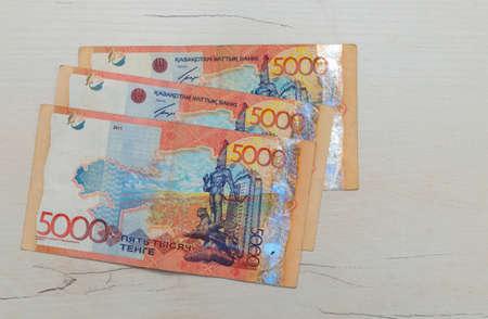 Kazakhstani tenge currency on the table. Stock Photo