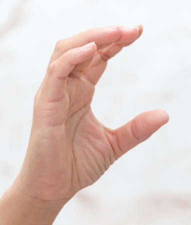 female hand wants to hold on a white background