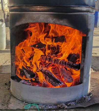 wood, fire is burning, coals in the stove, wood-fired heating concept 스톡 콘텐츠