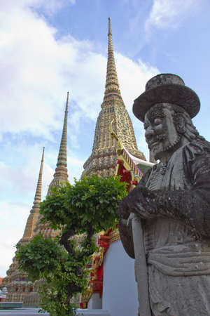 giant statue with tri pagodas