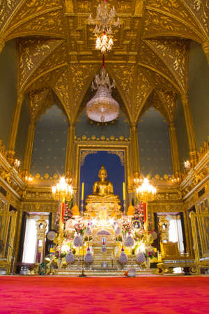 golden buddha image in temple photo
