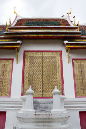 richly ornamented temple gates in thailand