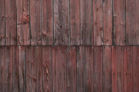 Closeup side of a weathered red barn, Stowe, Vermont, USA photo