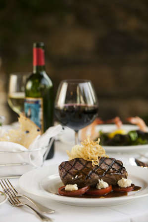 Steak dinner on white plate in a fine dining restaurant setting  photo